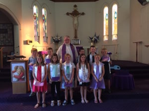 Father Joe and students at church
